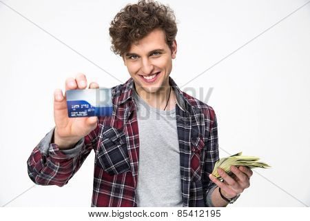 Smiling man holding banking card and cash in his hands