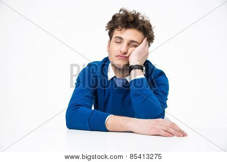 Tired businessman sleeping at the table over white background