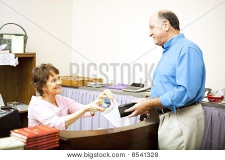 Disabled Clerk Serves Customer