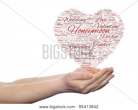 Concept or conceptual red love or Valentine`s Day wordcloud text in shape of heart symbol held in hands isolated on white background
