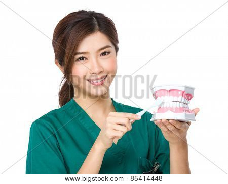 Asian doctor with toothbrush
