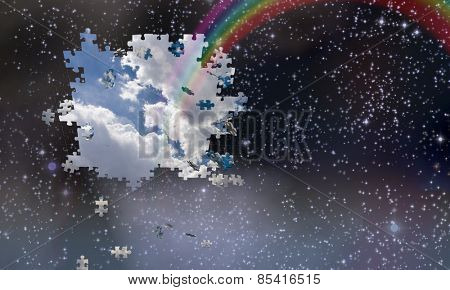 Puzzle pieces fall from night sky revealing day with rainbow