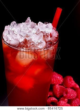 Red drink  with raspberry and cube ice on dark background.