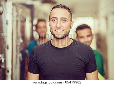 Young Arabic people in locker room at university