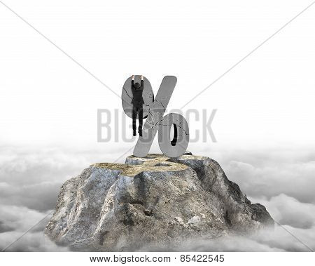 Businessman Hanging On Cracked Percentage Sign With Dollar Peak Cloudscape