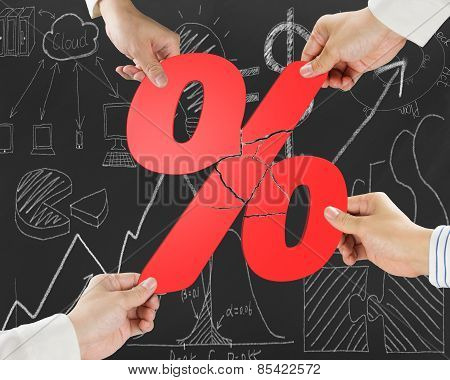 Group Of Business People Assembling Broken Red Percentage With Doodles