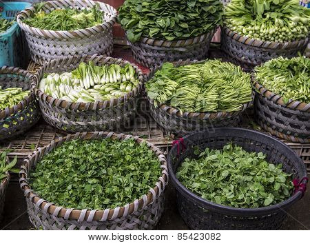 Asian vegetables in baskets.