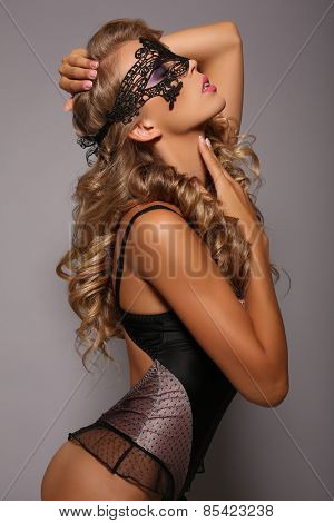 Sensual Girl  In Lingerie Corset With Long Blond Hair With Lace Mask