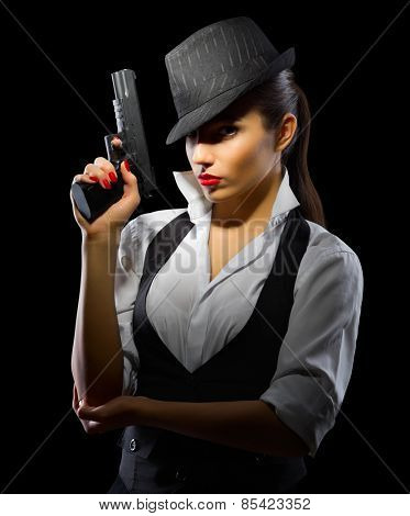 Young girl with gun on black