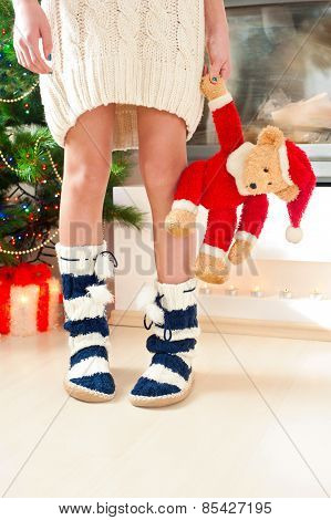 Teenage Girl Legs In Cozy Warm Woolen Socks With Pompons