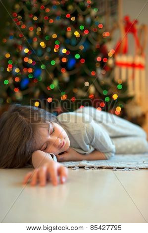 Dreaming About Christmas Miracles. Little Girl Sleeping Near New-year Tree