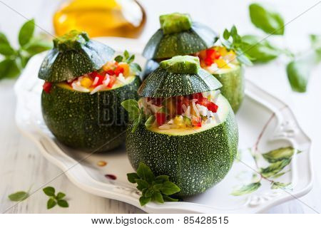 Round zucchini stuffed with vegetables and rice