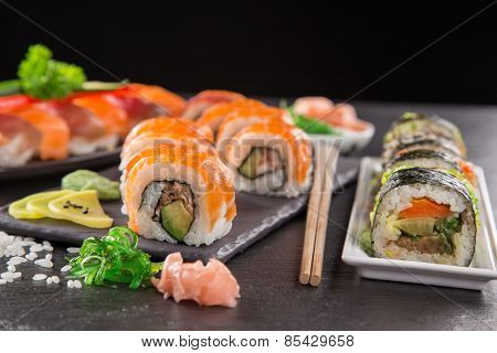 Japanese seafood sushi set on stone table, close-up.