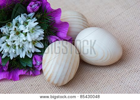 Snowdrop flowers and wooden eggs