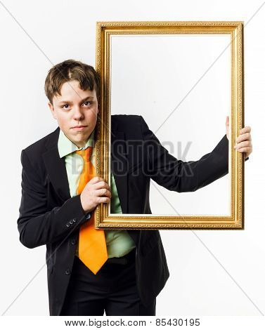 Expressive Teenage Boy Posing With Picture Frame