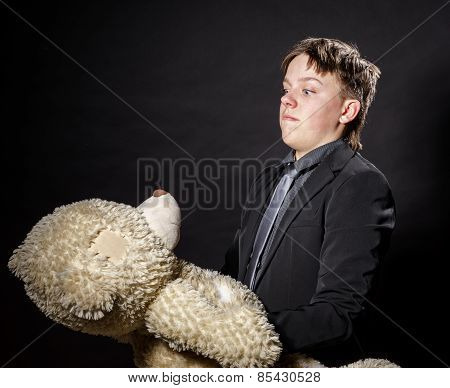 Teenage Boy Dressed In Suit With His Old Toy - Teddy-bear