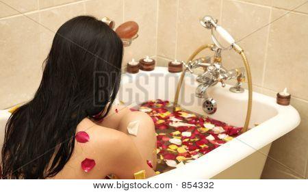 Woman Taking Rose Petal Bath