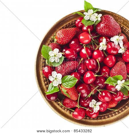 Sweet cherries and strawberries collection surface close up isolated on white background