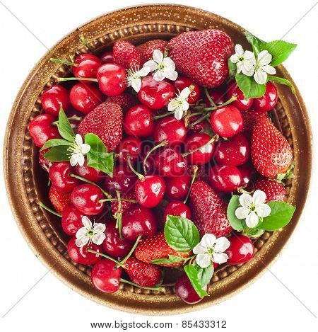 Sweet cherries and strawberries flowering collection surface top view close up isolated on white background