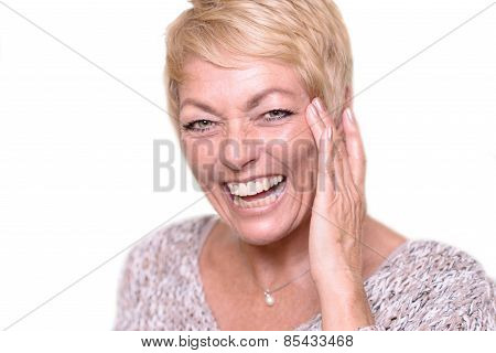 Laughing Blond Adult Woman Touching Her Face