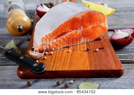 Salmon Steak On A Cutting Board. Cooking Concept