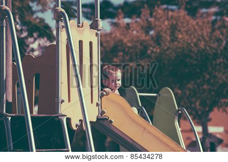 Vintage Photo Of Child Boy On Slide At Playground