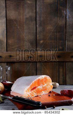 Fresh Raw Salmon Steak Slices On Wooden Background