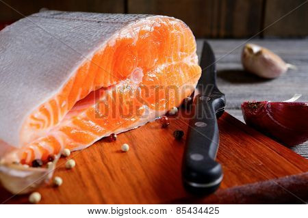 Delicious Portion Of Fresh Raw Salmon Steak Slices With Spices