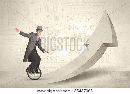 Happy business man riding a monocycle up on an arrow concept