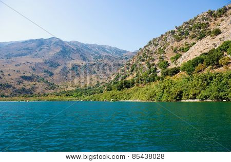 Landscape. Picturesque mountain lake on a sunny summer day.