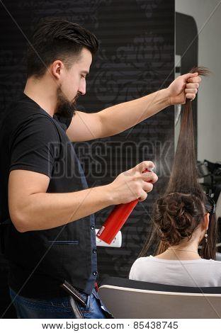 Professional hairdresser man at work