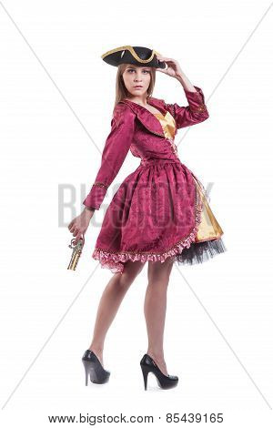 Woman in pirate carnival costume with pistol . Isolated on white