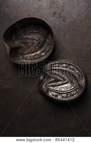 abstract picture with Vintage horse shoe shape Baking Tins or moulds, tiny focus