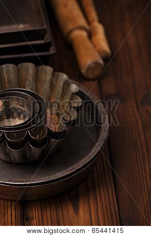Vintage  Baking Tins and tools on wooden background