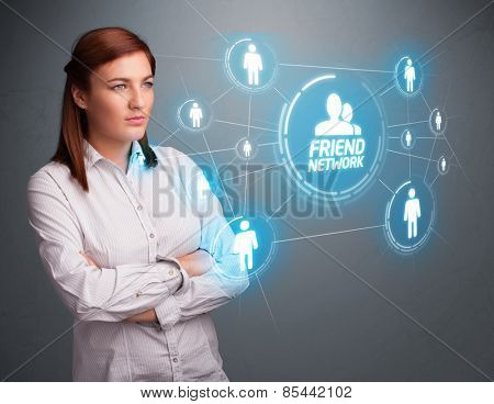 Attractive young girl looking at modern social network