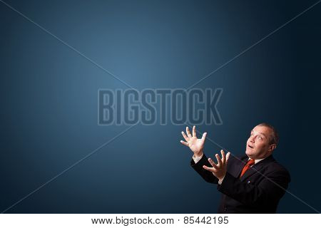 funny businessman in suit gesturing with copy space