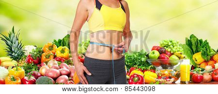 Healthy vegan diet. Woman measuring her body.