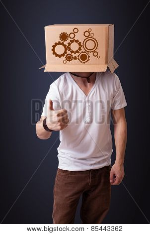Young man standing and gesturing with a cardboard box on his head with spur wheels