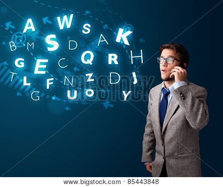 Handsome young boy making phone call with shiny characters