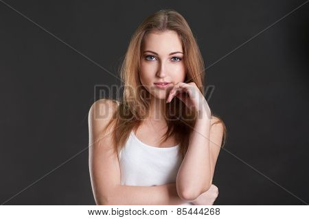 The Self-confident Girl Thoughtfully Smiles
