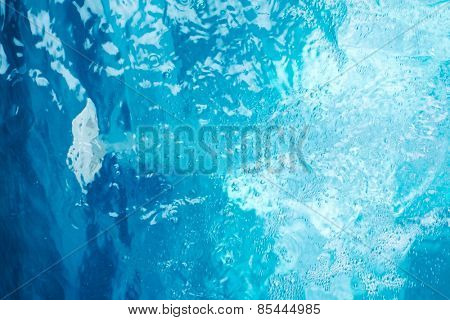 Blue clear fresh Water in jacuzzi. Spa massage background.