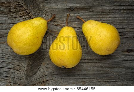 Fruit background. Fresh organic pears on old wood.
