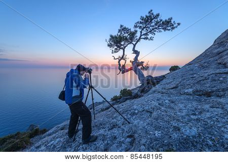 photographer on the morning seascape