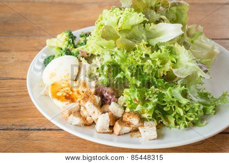 Homemade Salad Serving On Wooden Background