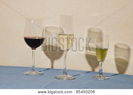 Three glass and their shadows