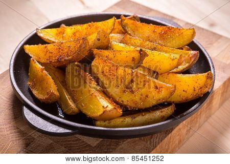 baked sliced potatoes on pan