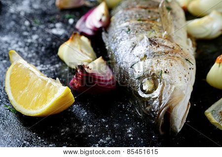 Delicious Fried Sea Bass With Lemon And Onion On A Tray