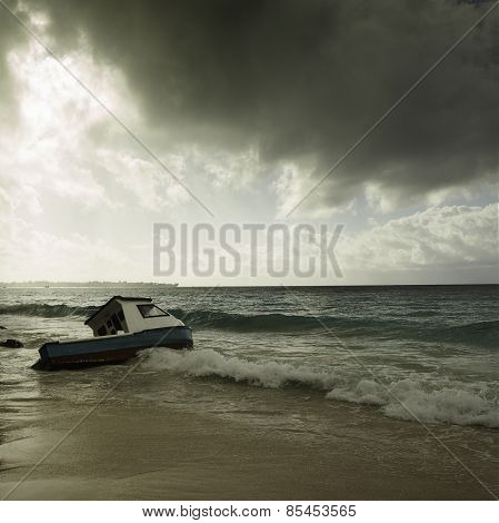 Stormy Weather And Fishing Boat Stranded On A Beach