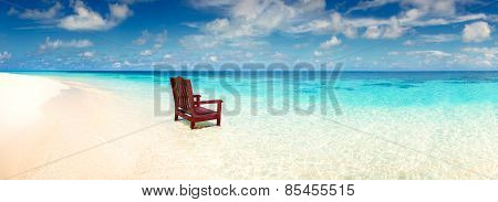 Wooden chair standing in the sea