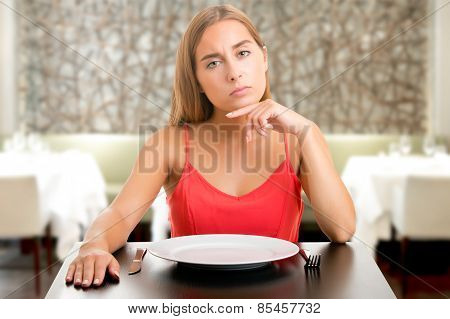 Hungy Woman Waiting With An Empty Plate